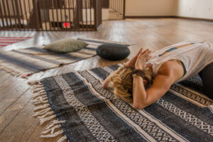 LouAnn McBride teaching Restorative Yoga classes at the Center of Harmony, Childs pose