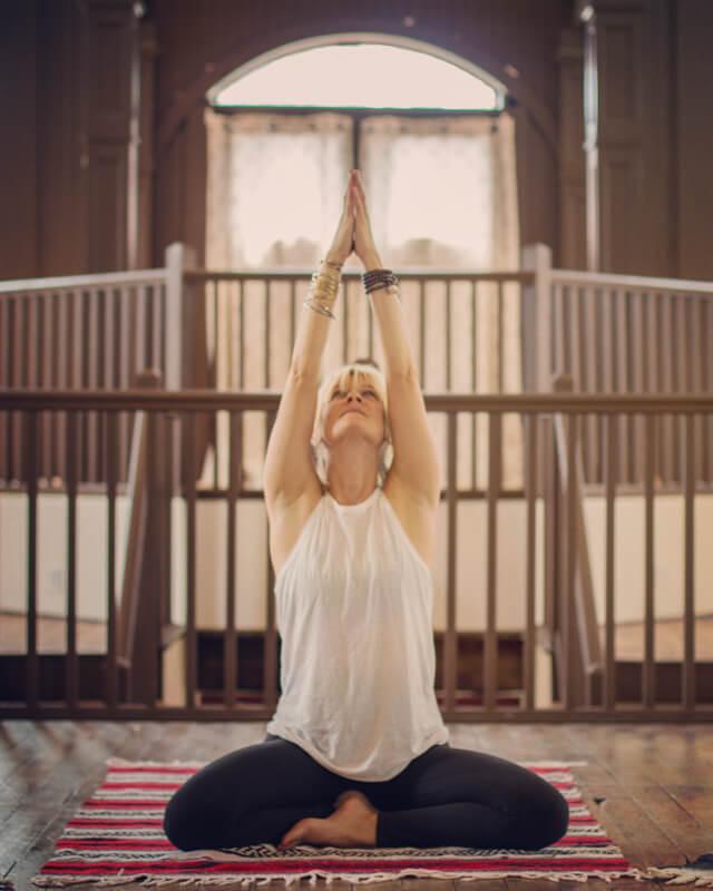 LouAnn McBride teaching Restorative Yoga classes at the Center of Harmony