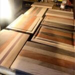 Murderingtowne Press and Company customers cutting boards.