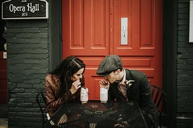 Young Attractive couple drinking coffee in front of the Center of Harmony